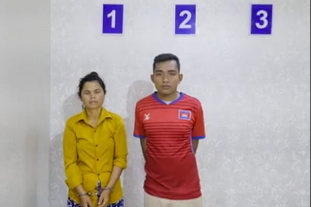 Two suspects pose for a police photo last week after they were arrested for the murder of a Kampong Cham taxi driver. National Police