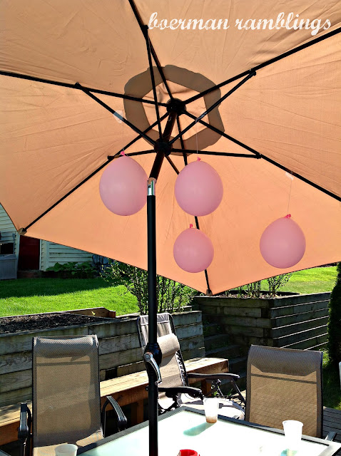 balloons hanging from umbrella