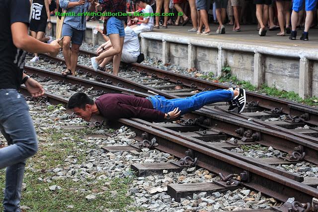 Man planking on Rail lines, Tanjong Pagar Raiway Station, Singapore