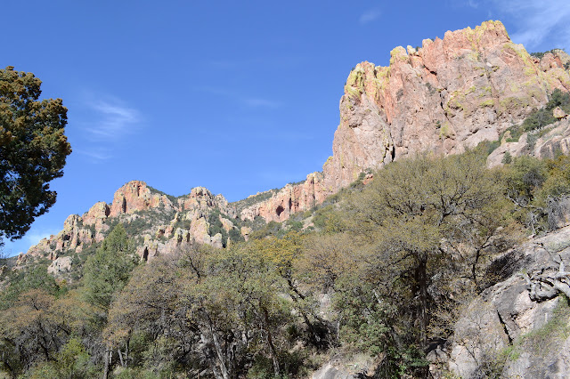 high cliffs high on the canyon side with shallow caves