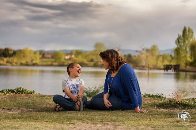 a brother and sister having fun and laughing for their family portrait session
