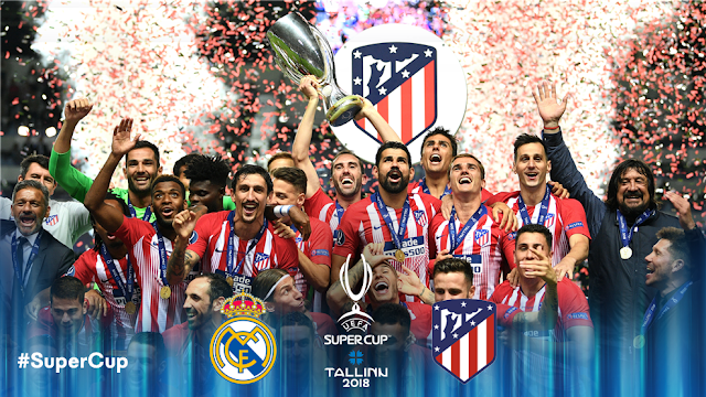 Atletico Madrid players lift UEFA Super cup trophy