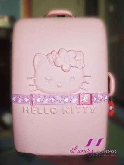 travel blogger pink hello kitty luggage bag wanderlust