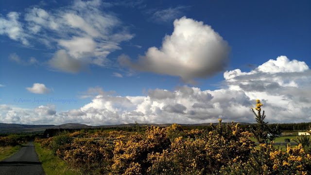 Beautiful blue sky and puffy white clouds, Connemara landscape