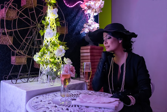 A Stylish Love Story Fashion Blog Joanna Joy Petite Blogger Handmade Umbrella Parisian Lace Balloon Ferris Wheel Flowers Imagination Scenery Set Design Black and White Pearls Vintage ruffle hat black leather belt white metal floral cafe table pink led Love string lights pink sparkling champagne