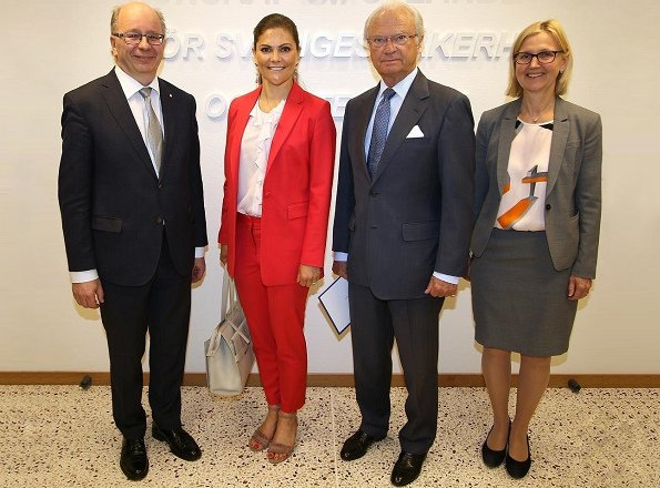During her visit to the National Defence Radio Establishment, Crown Princess Victoria of Sweden wore a red jacket and trousers by Lexington Company