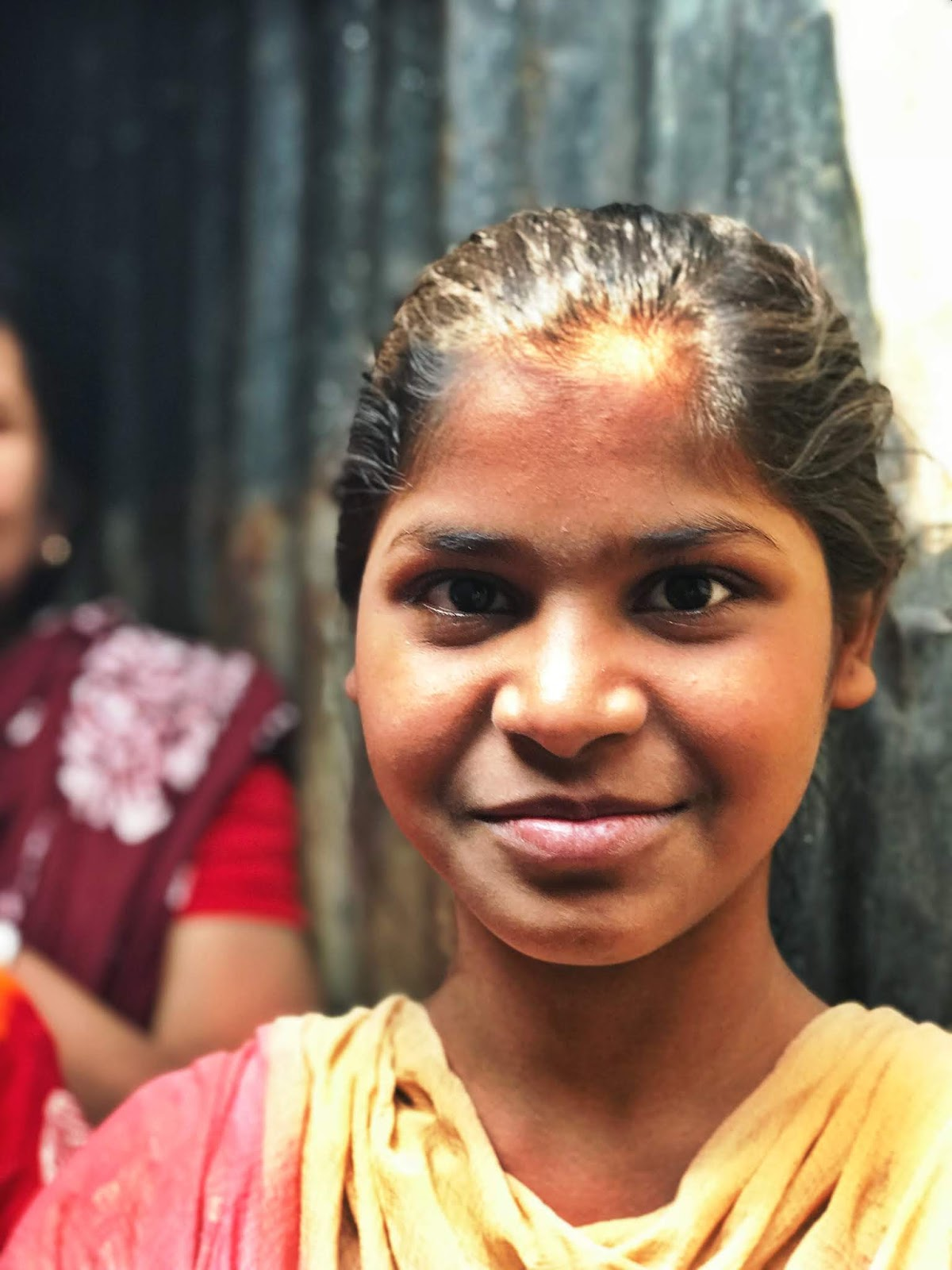 girl smiling in bangladesh child sponsorship world vision