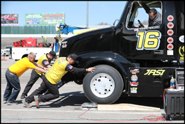 The Bandit track crew helps move the #16 truck off its blocks at Motor  Mile Speedway on Saturday, April 21, 2018