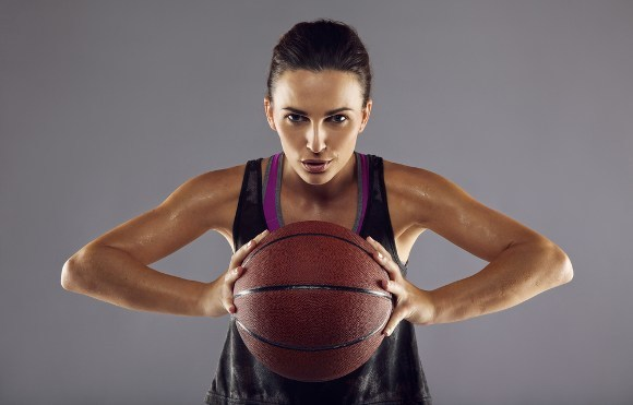 Sporty lady Holding Basketball