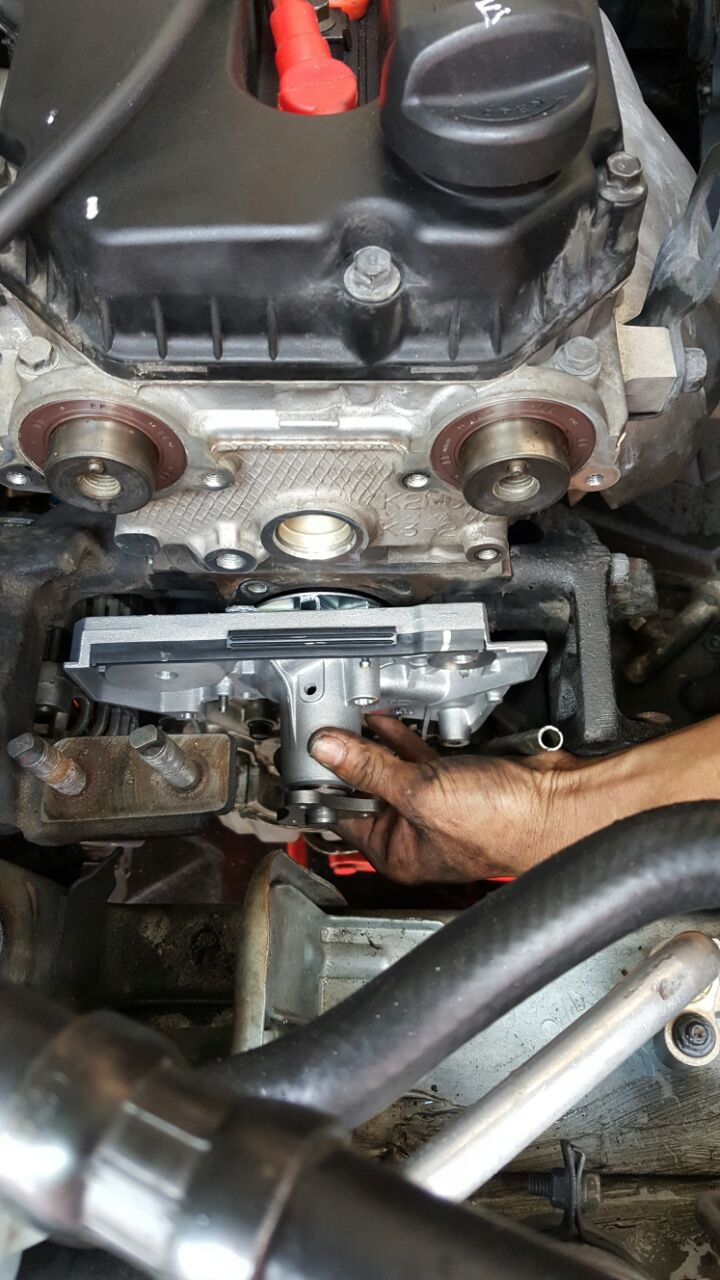 small resolution of timing belt replacement photo shows genuine waterpump is being install