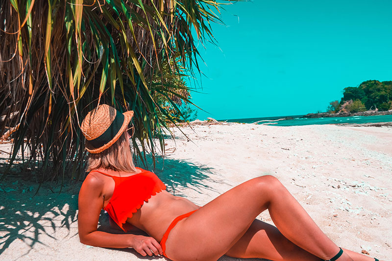 girl on frankland island beach far north queensland wearing red scallop bikini