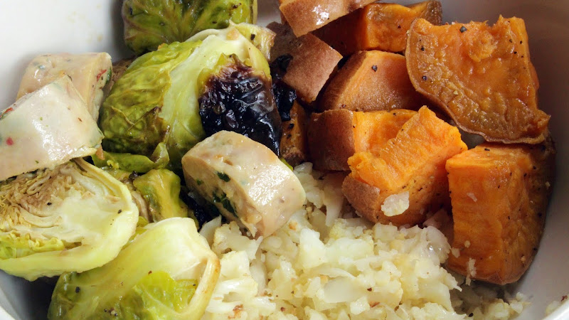 A meal for anytime! (Cauliflower rice sweet potato Brussels and sausage buddha bowl)
