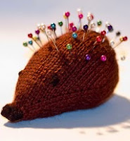 http://www.ravelry.com/patterns/library/waste-yarn-hedgehog