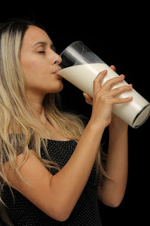 woman drinking huge milk.jpeg