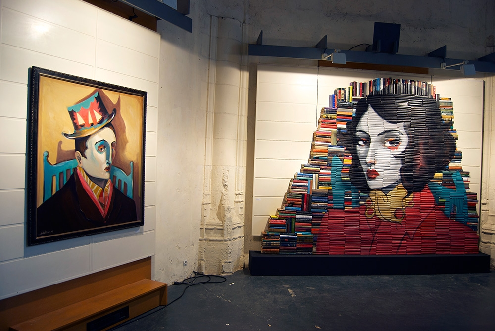 09-Mike-Stilkey-Books-used-as-Canvasses-for-Paintings-www-designstack-co