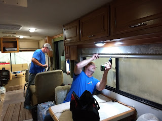 men working on motorhome window