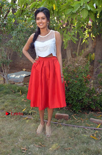 Actress Mahima Nambiar Latest Stills in White Top and Red Skirt at Kuttram 23 Movie Press Meet  0040.jpg