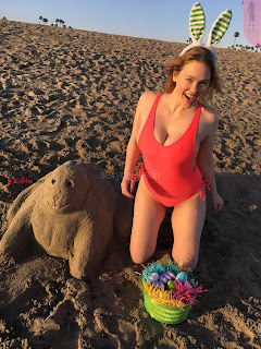 Maitland Ward exposing her soft body Cleavages sexy Ass in one piece swimsuit for an Easter Themed Picture shoot
