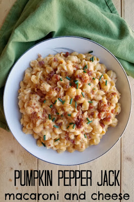bowl of mac and cheese with bacon and chives on top
