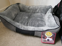 scruffs chester bed in black and grey on floor