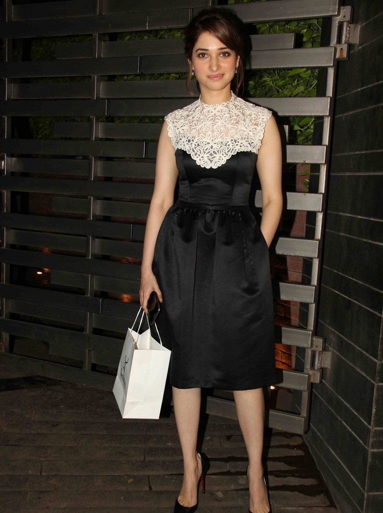 Hot Actress Tamannaah Bhatia Legs Thighs Show Stills In Mini Black Dress