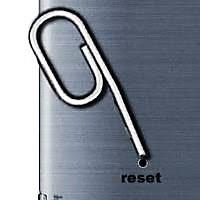 Botão Reset com clip metálico