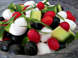 Mozzarella Cheese Salad with tomatoes, black olives and cucumbers