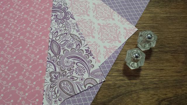 Refinished roll top desk, scrap book paper, vintage glass knobs