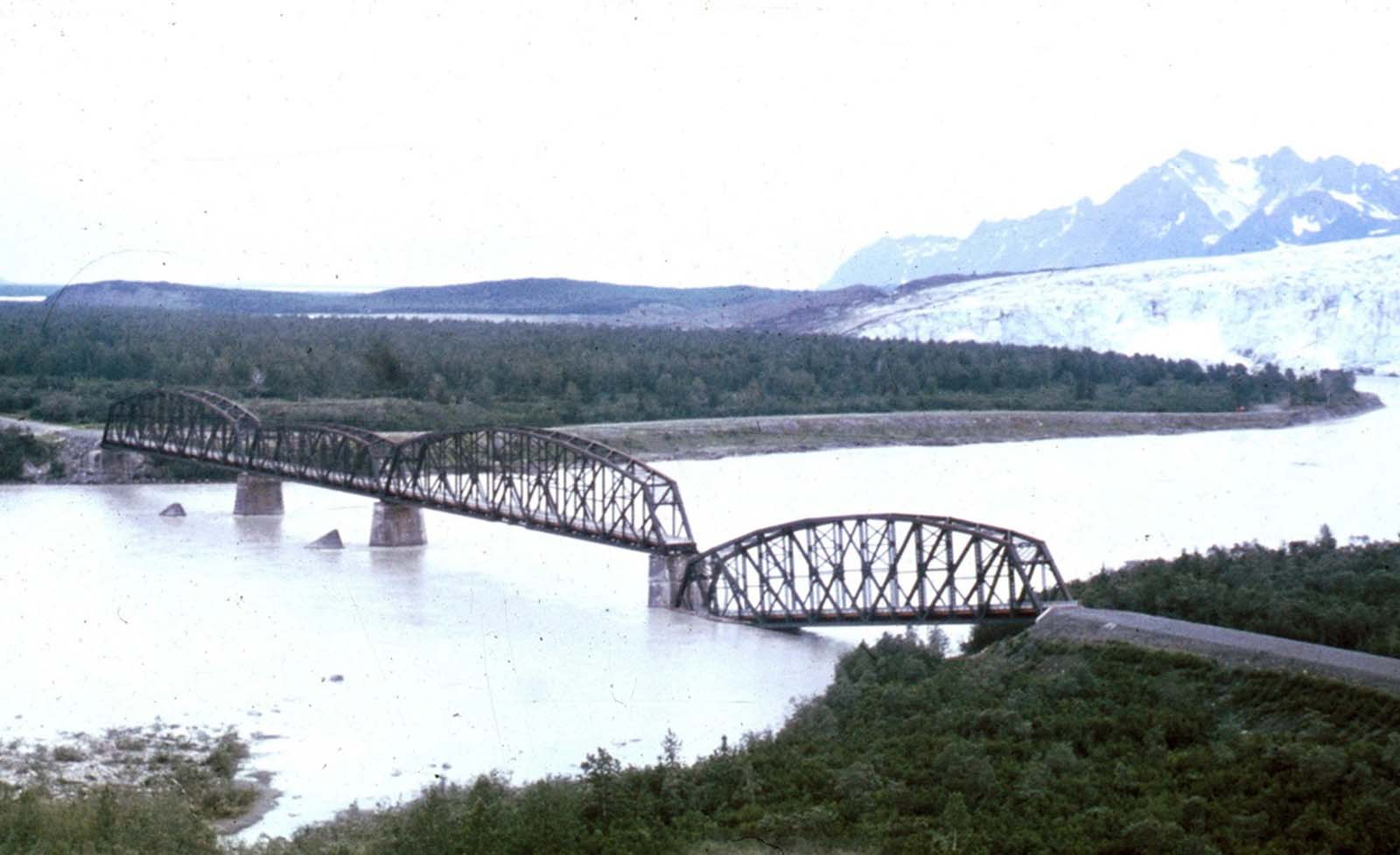 One span of the 'Million Dollar bridge' of the defunct Copper River and Northwestern Railroad was dropped into the Copper River by the earthquake.