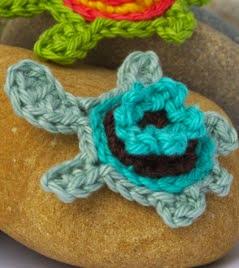 http://www.mycrochetprojects.com/blog-content/uploads/2013/11/Gehaekelte-Schildkroeten-Applikation-Crochet-turtle-applique.pdf