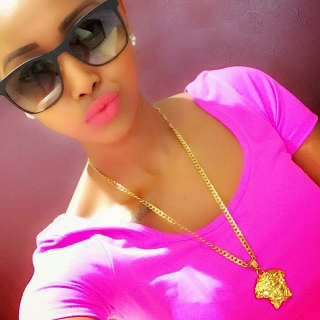 Hudda Monroe shinning in an Original Versace necklace