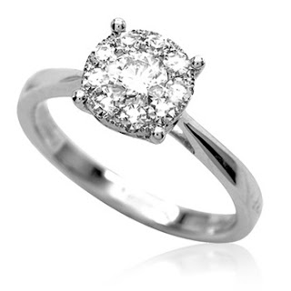 solitaire surrounded by 9 smaller diamonds