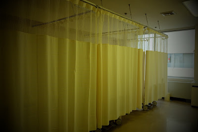 Curtained off beds in the ward of a Tokyo hospital.