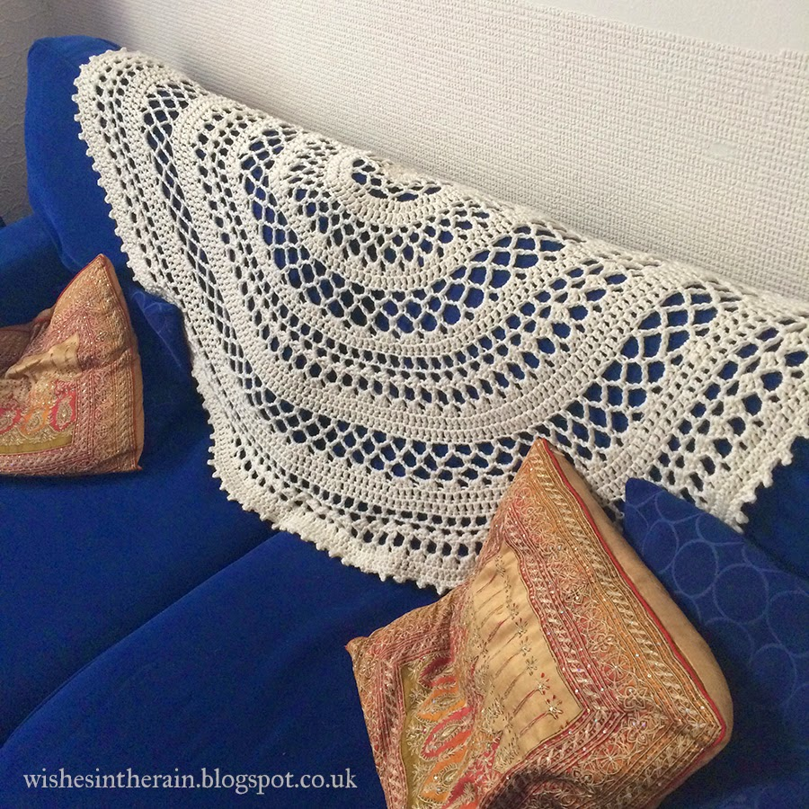 crochet throw over the back of a sofa