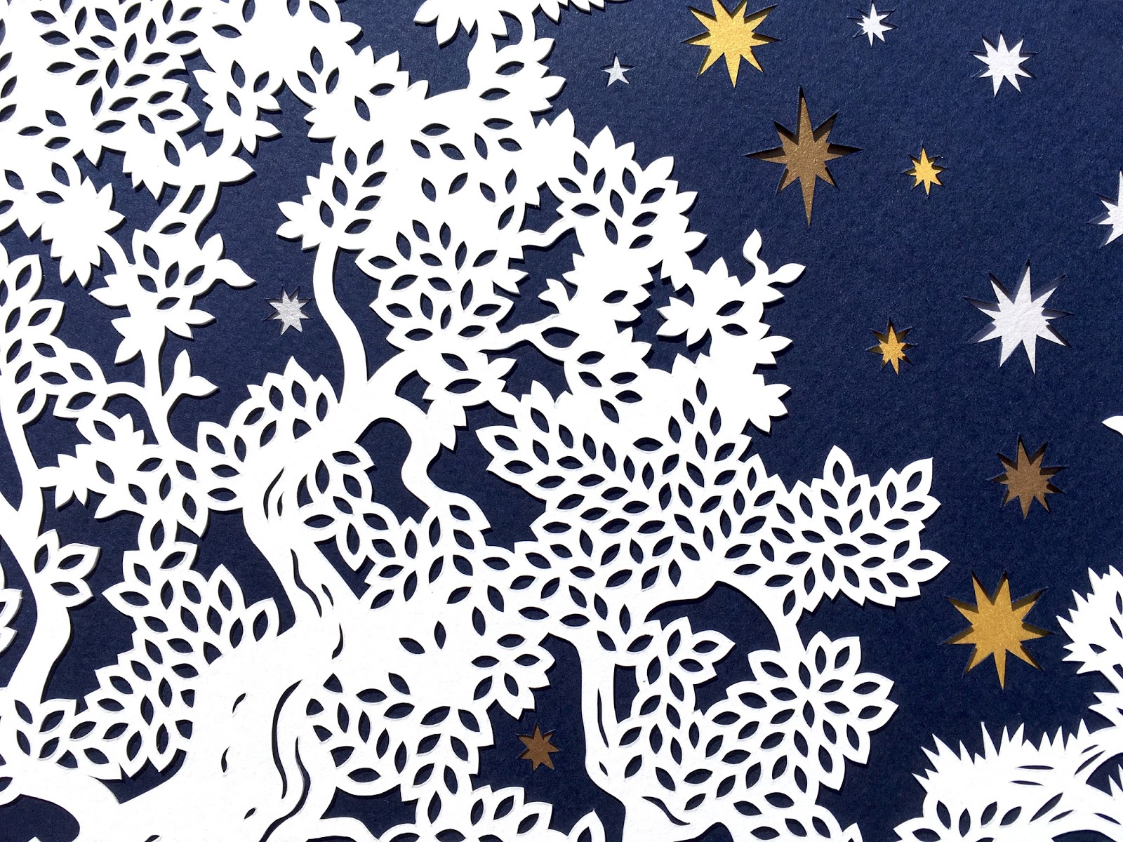 papercut ketubah detail shot of starry night design by Naomi Shiek. Papercut tree and stars
