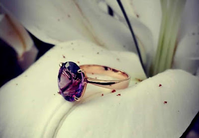 Amethyst set in a solitaire engagement ring