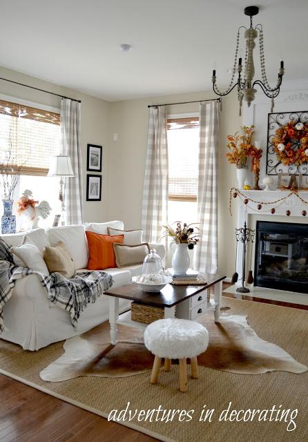 Fall mantel, cow hide rug, plaid throw on sofa, sisal rug, little stool