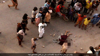 EXECUTED FOR BEING GAY ISIS thugs throw homosexual off tall building and pelt his corpse with rocks