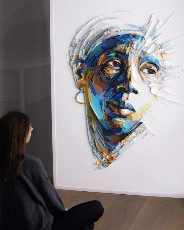 quilled portrait of woman with artist looking on