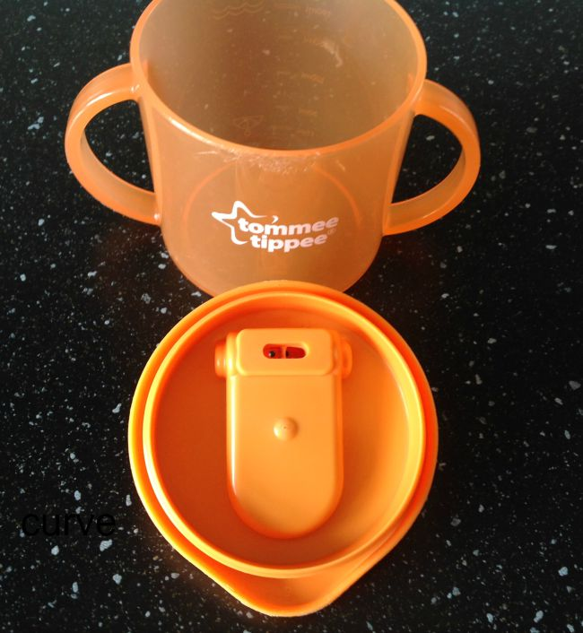 How-to-open-a-Tommee-tippee-sippy-cup-without-breaking-your-nails-image-of-orange-tommee-Tippee-cup-showing-curve-in-lid