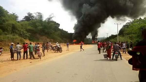 Image result for Breaking: Tanker loaded with kerosene falls and catches fire, claiming the lives of all passengers in a bus