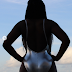 Photos: OAP Gbemi Flaunts Her Derriere In A Foiled Silver 1-piece Swimsuit