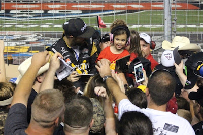 Verizon IndyCar Series Drivers James Hinchcliffe, Josef Newgarden and Conor Daly Sign Autographs during Rain Delay at Texas Motor Speedway