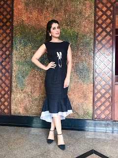 Raashi Khanna looks supre cute in a plain Black Sleeveless Dress