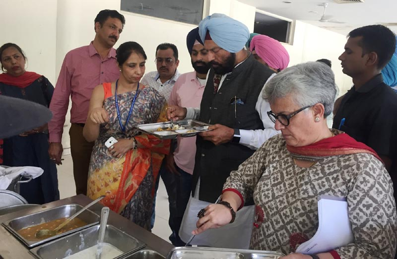 The Sports Minister Rana Gurmit Singh Sodhi checking mess food during his visit