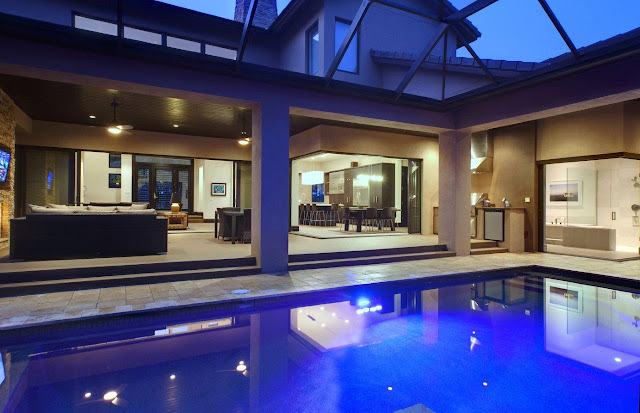 Picture of large swimming pool by the living room