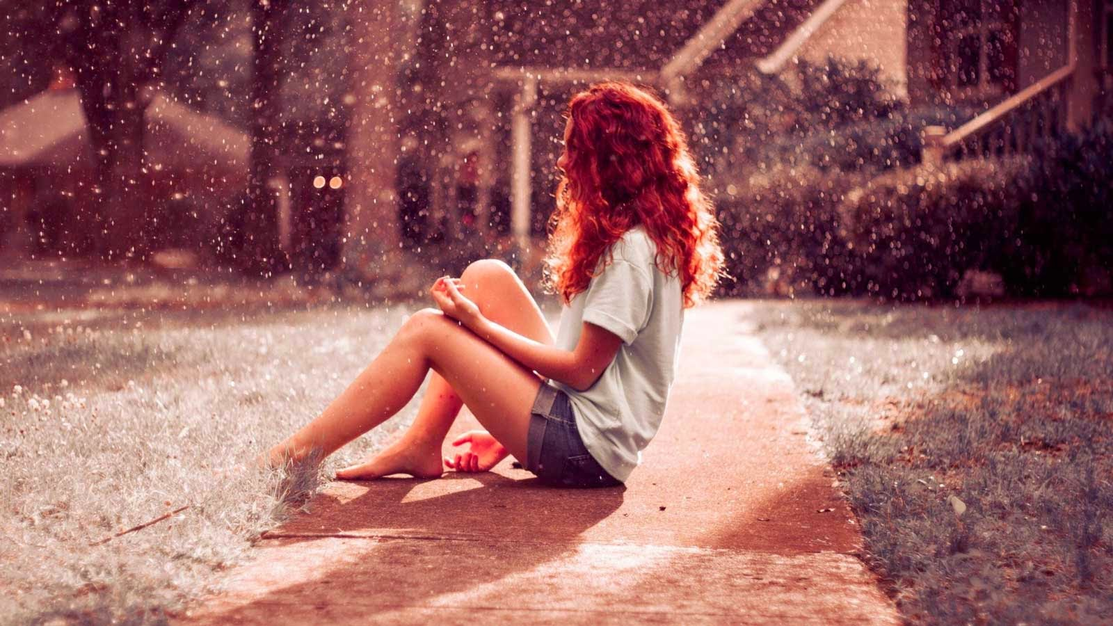 Red Hair Female Enjoying Rain Water