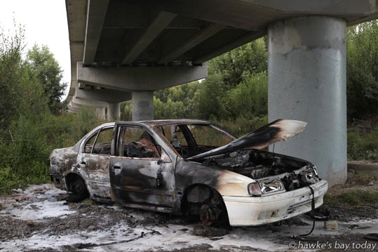 Police and the Hastings Fire Service attended a suspicious car fire under the Hawke's Bay Expressway bridge over Ngarurorro River, near Ormond Rd, Hastings. photograph