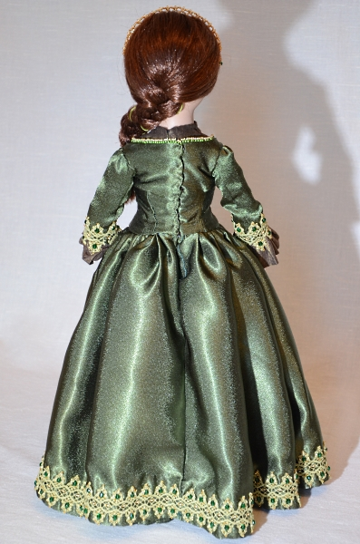 Handmade green dress for porcelain doll.