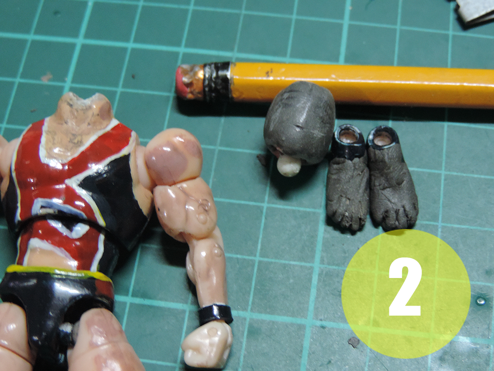 In Figure 2. Wrapped with putty and slice it to have toes.